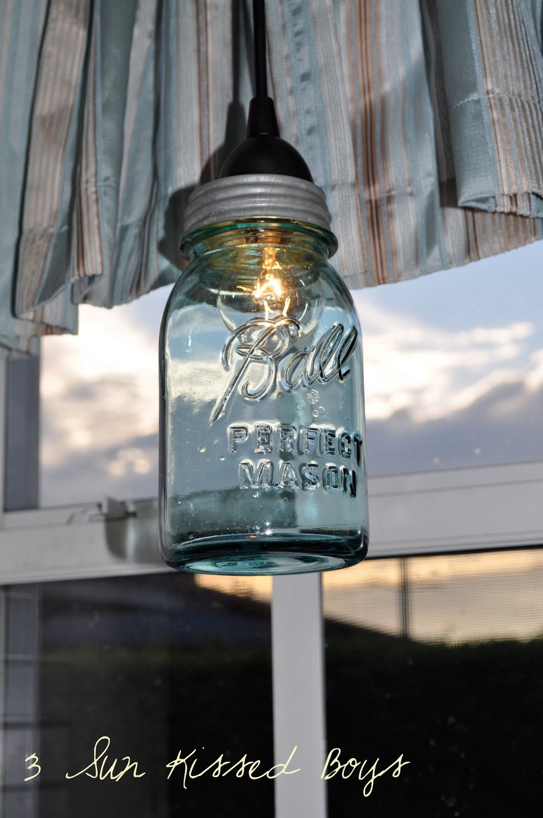 Remodelaholic 14 great diy pendant lights and link party for Hanging lights made from mason jars