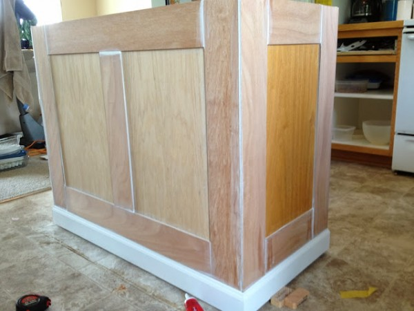 caulking board and batten on the kitchen island, featured on Remodelaholic