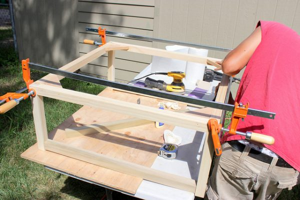 clamp the legs while building a modern coffee table, Home Coming featured on Remodelaholic