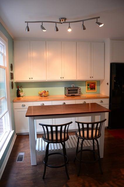 Superb custom open kitchen island New Green Mama via Remodelaholic