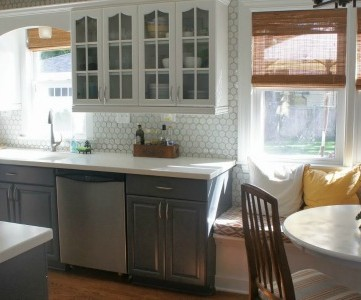 gray and white kitchen makeover with painted cabinets, featured on Remodelaholic