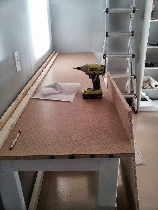 finished DIY workbench, featured on Remodelaholic.com