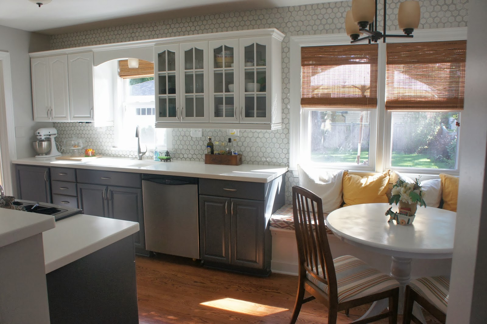 Unique gray and white kitchen makeover with painted cabinets LoveLee Homemaker featured on Remodelaholic