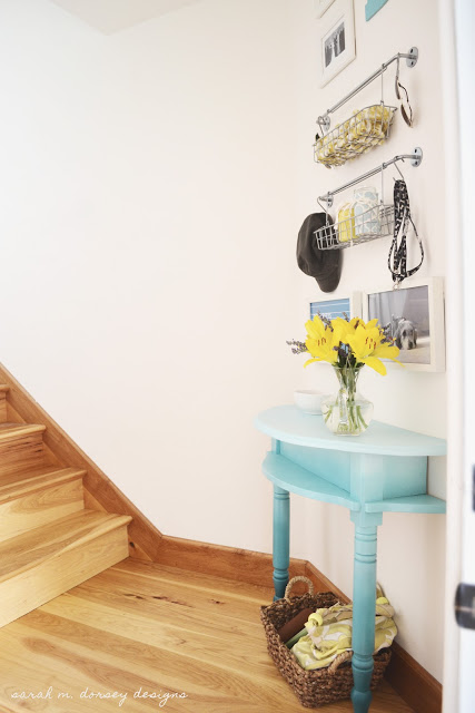 half console table with organized entryway gallery wall, Sarah M Dorsey Designs via Remodelaholic