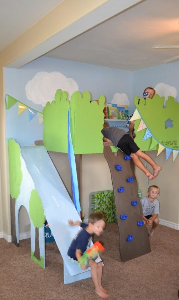 kids playing in the indoor treehouse loft, I Am Hardware featured on Remodelaholic