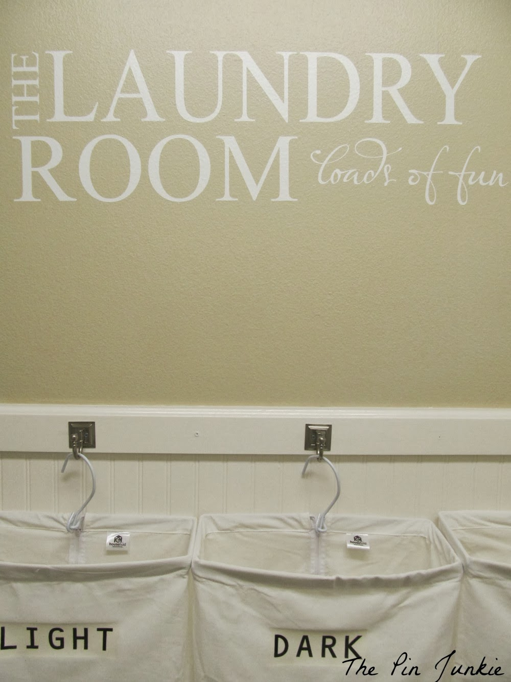 Fabulous laundry room makeover with vinyl decal The Pin Junkie featured on Remodelaholic