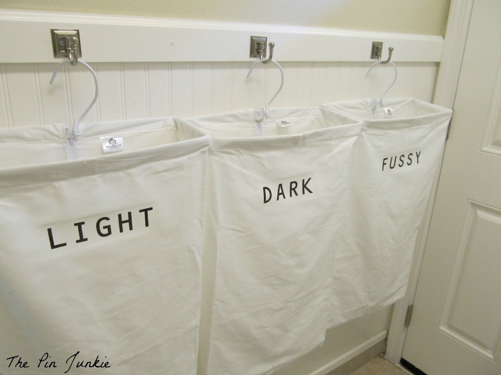 Remodelaholic laundry room makeover with personalized hanging laundry bags - Small space bags ideas ...