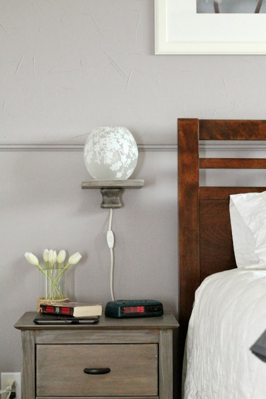 bedside storage solution: modern floating shelf with lamp, Turtles and Tails featured on Remodelaholic.com