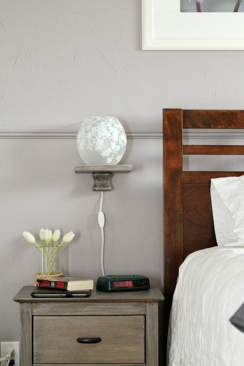 bedside storage solution: modern floating shelf with lamp, Turtles and  Tails featured on Remodelaholic