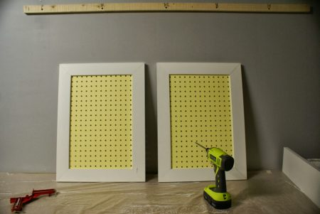 pegboard sliding doors for tool organizer cabinet, featured on Remodelaholic.com