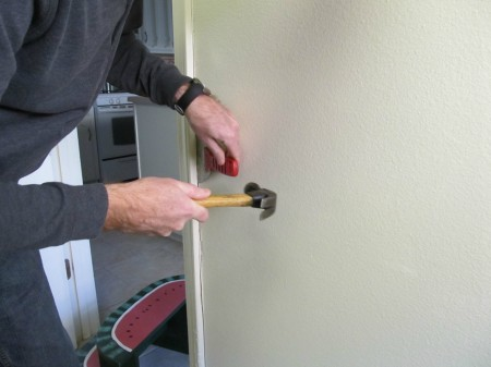 replacing door trim - laundry room makeover, The Pin Junkie featured on Remodelaholic.com