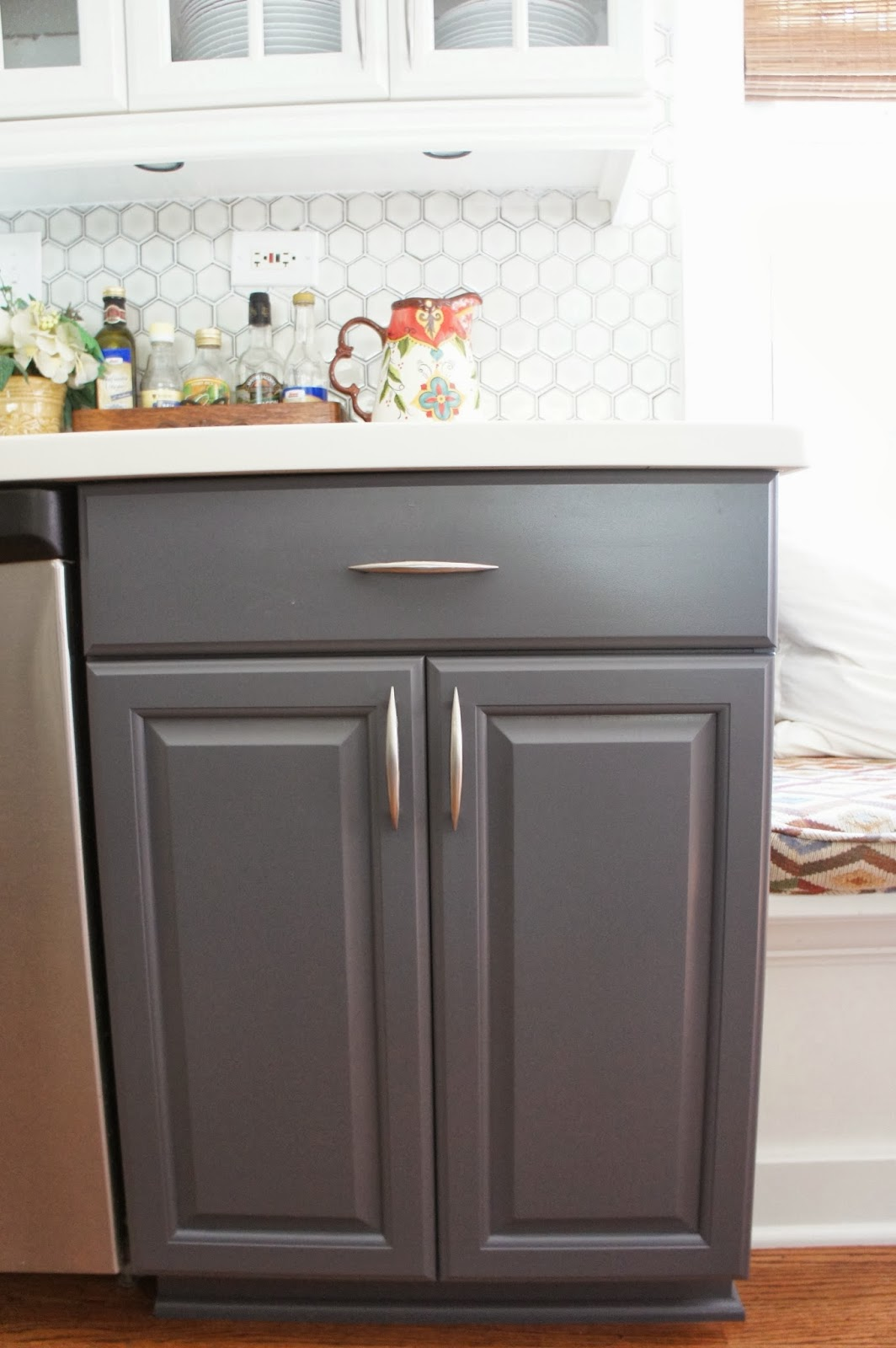 Elegant two tone gray and white painted kitchen cabinets LoveLee Homemaker featured on Remodelaholic