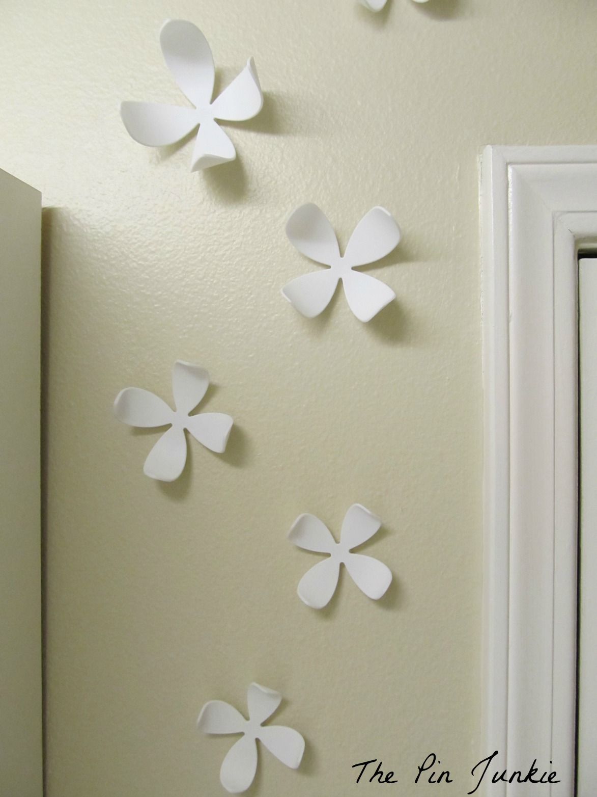 remodelaholic laundry room makeover with personalized hanging umbra 3d wall flowers in laundry room the pin junkie featured on remodelaholic com