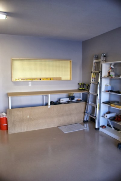 wall-mounted pegboard tool cabinet, featured on Remodelaholic.com