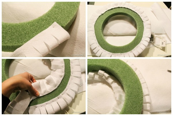 Attaching the felt to the wreath form for a diy snowman wreath from Remodelaholic