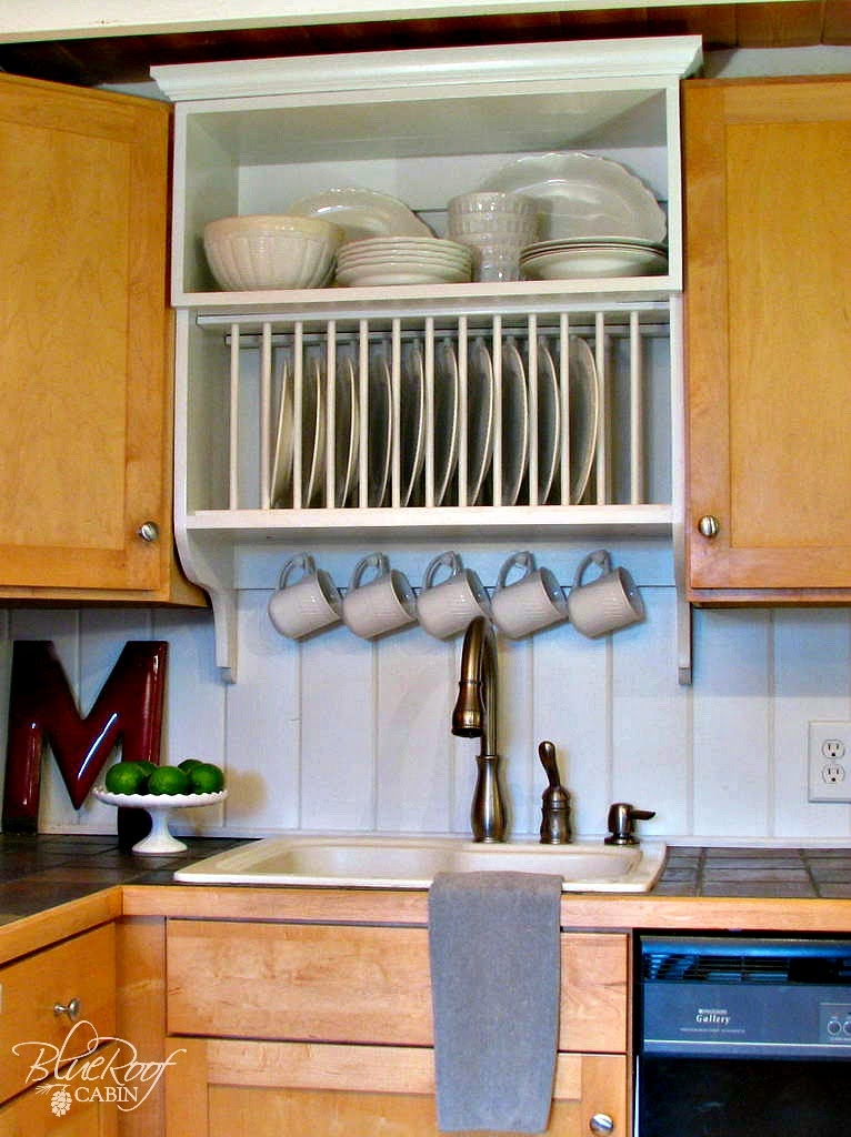 Cute custom plate rack cabinet Blue Roof Cabin featured on Remodelaholic