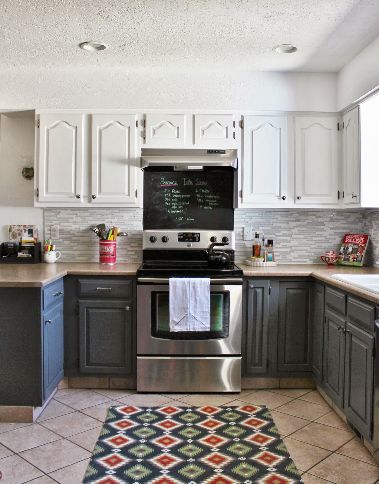 grey and white kitchen with tile backsplash and chalkboard house for five featured on remodelaholic