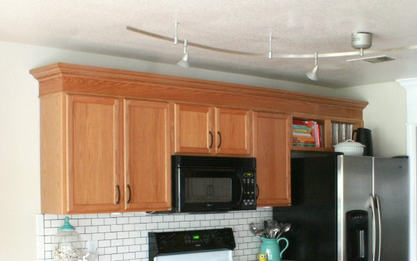 Remodelaholic how to diy a custom range hood for under 50 for Attaching crown molding to kitchen cabinets
