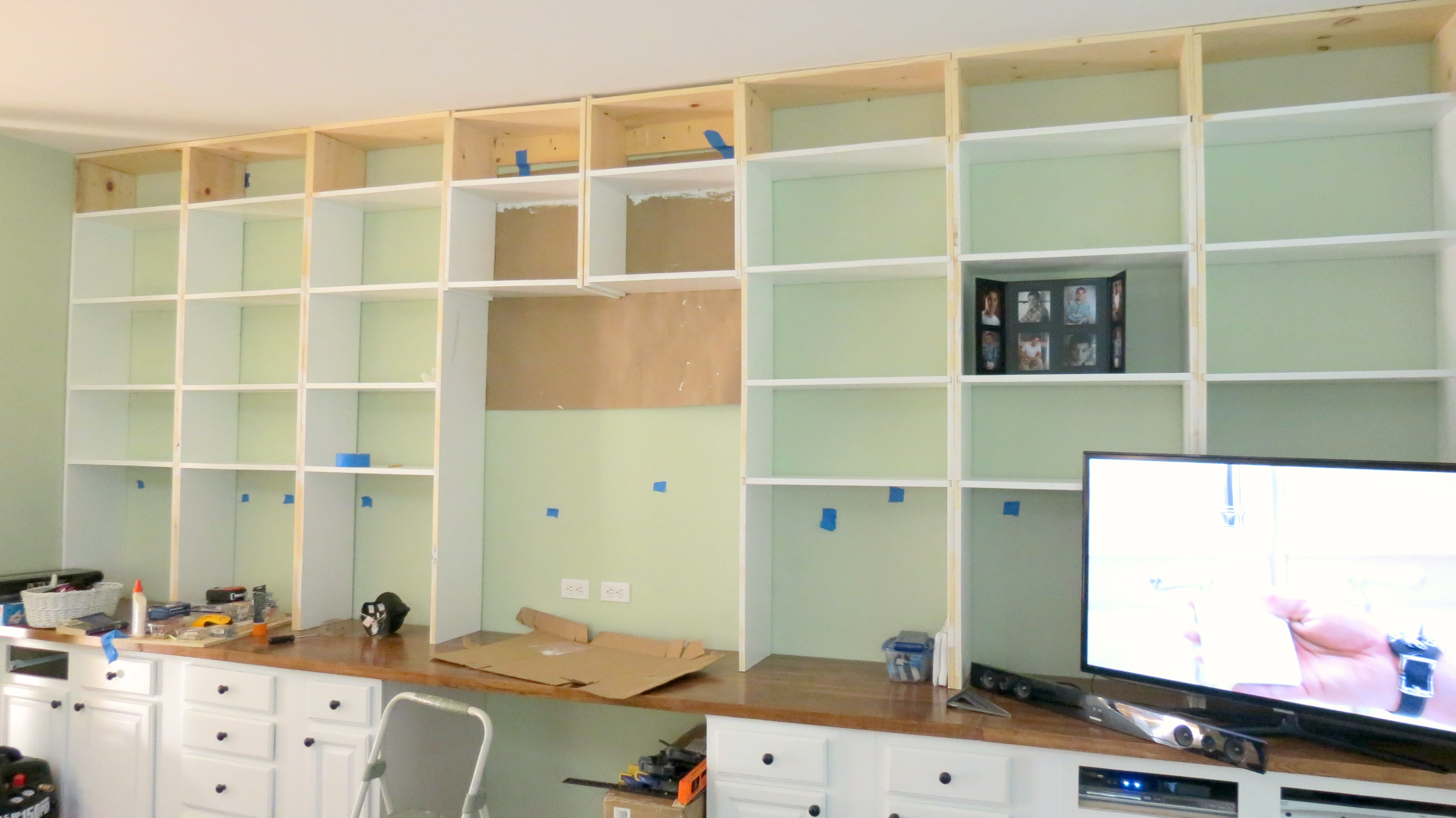 ... install wall-to-wall built-in bookcases over a desk, Home Is