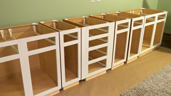 paint built-in desk cabinets white, Home Is Where My Heart Is featured on Remodelaholic