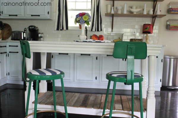 renovated kitchen with subway tile backsplash, painted cabinets, and custom island, Rain On A Tin Roof featured on Remodelaholic