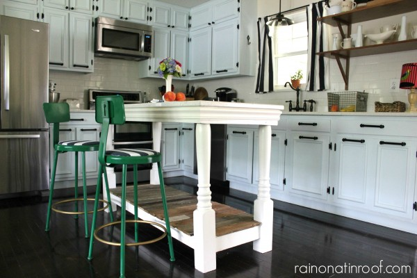 white painted cabinets and custom island in renovated kitchen, Rain On A Tin Roof featured on Remodelaholic
