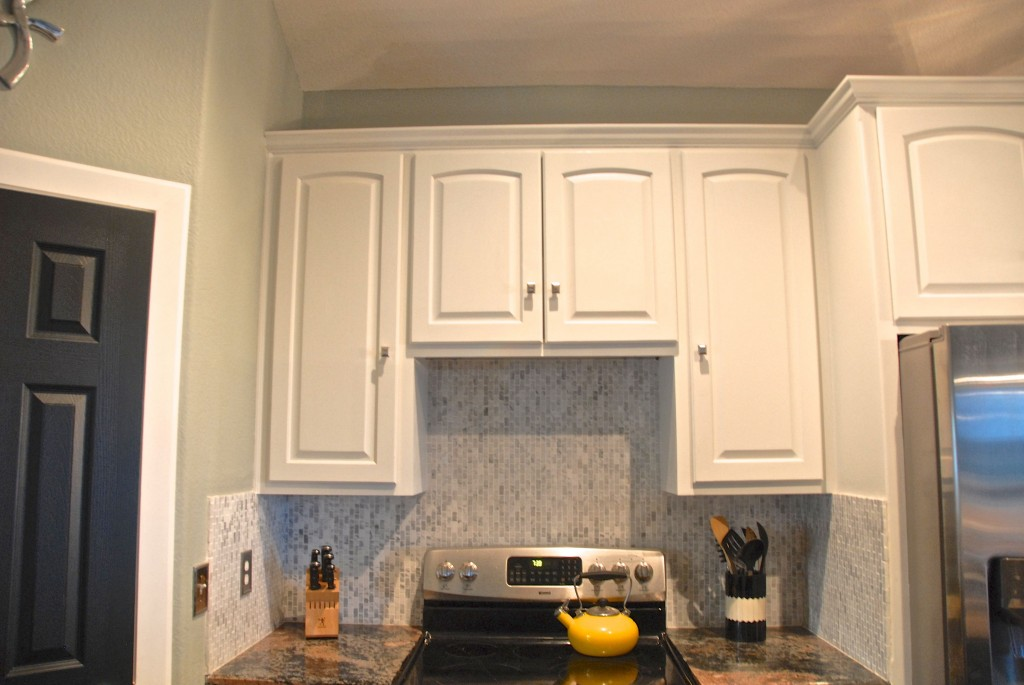 White Painted Kitchen Cabinets, The Rozy Home Featured On Remodelaholic.  Cabinet Over Stove Before Range Hood ...