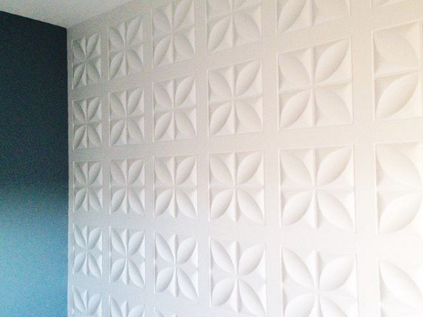 All white panel wall in bedroom by Mesmerizing Moments featured on @Remodelaholic