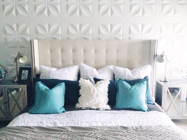 White 3D panel wall as bedroom focal point by Mesmerizing Moments featured on @Remodelaholic