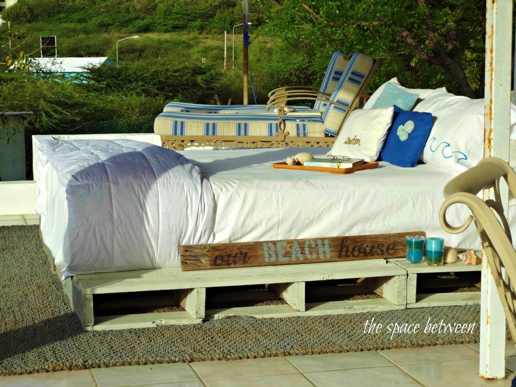 Luxury beach cottage bedroom style beach house rooftop pallet bed featured on Remodelaholic