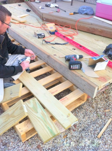 building a tiered wooden pallet deck, The Second Wind of Texas featured on Remodelaholic