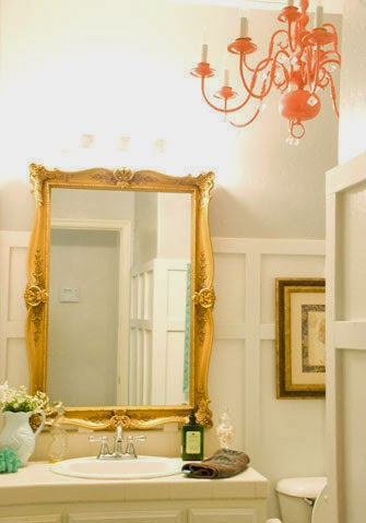 chic bathroom makeover with chandelier and gold mirror, Vintage Romance featured on Remodelaholic
