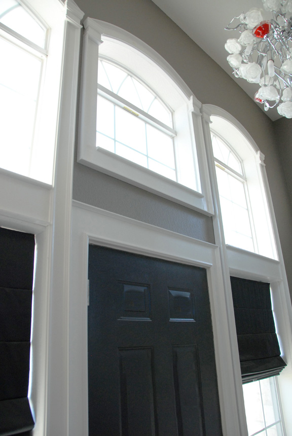 Finished Windows With Arched Trim The Rozy Home Featured On Remodelaholic
