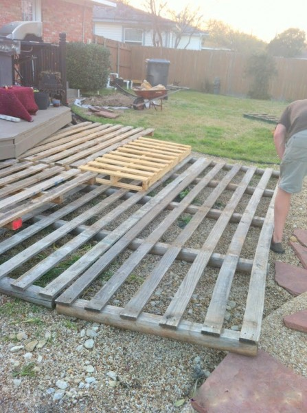 laying out the pallets for the deck, The Second Wind of Texas featured on Remodelaholic