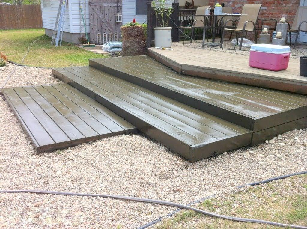 Remodelaholic build a wooden pallet deck for under 300 for Pallet outdoor flooring