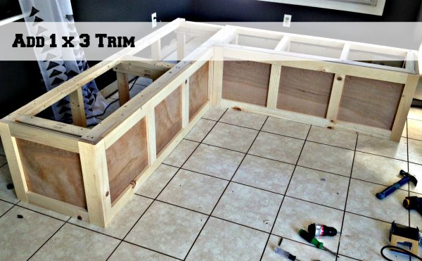use 1x3s to trim a banquette corner bench, Pinterior Designer featured on Remodelaholic