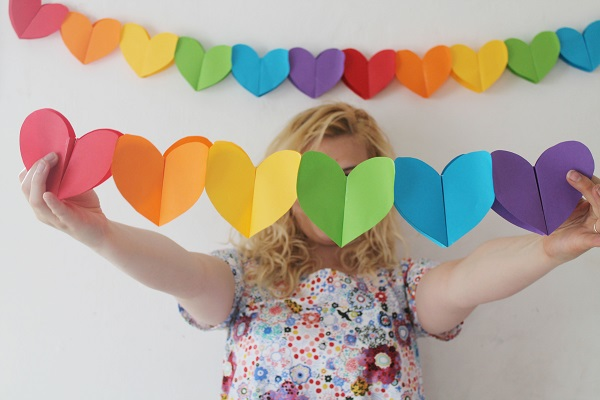 DIY Foldable Heart Garland and more Valentine Crafts for Kids featured on Remodelaholic.com