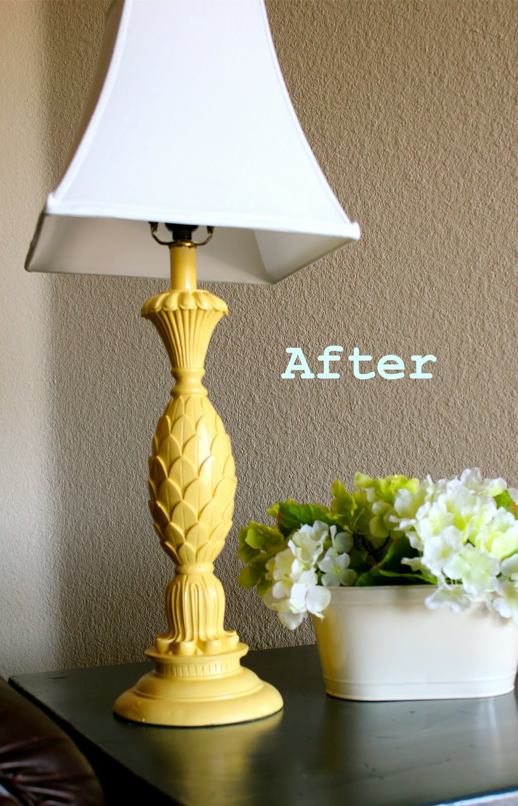 Simple spray painted lamp base featured on Remodelaholic