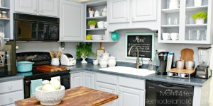 Use peel and stick vinyl flooring to make a plank wall backsplash