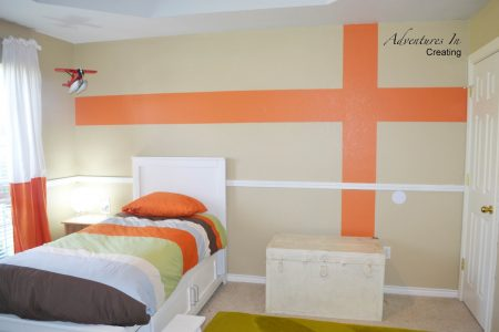 boys room with orange accents