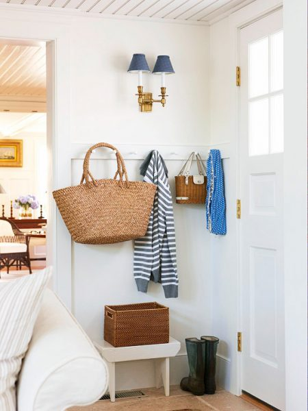 entryway mudroom area behind the door, BHG via Remodelaholic