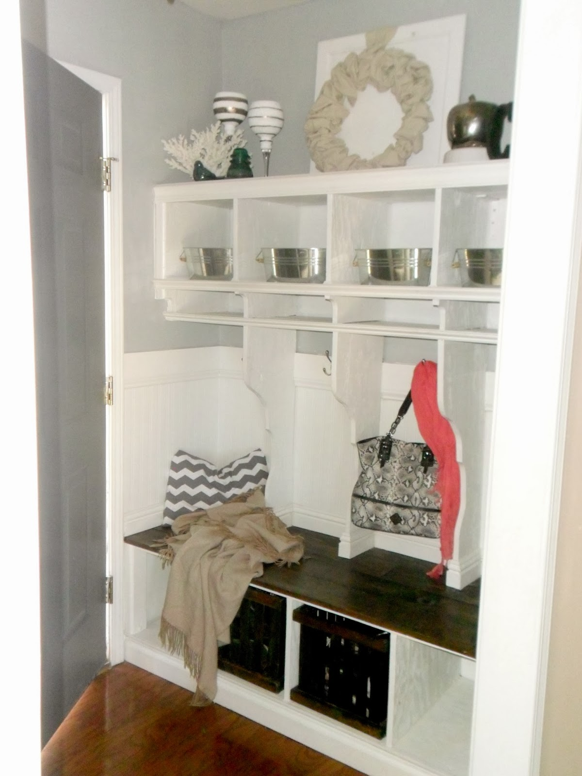 Remodelaholic diy entryway mudroom with cubbies for Hallway lockers for home