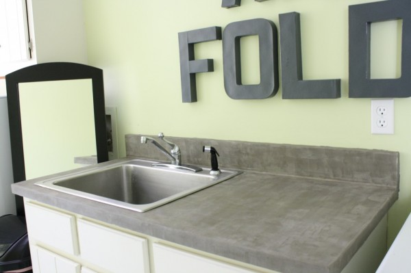 laundry room cement countertops, featured on Remodelaholic