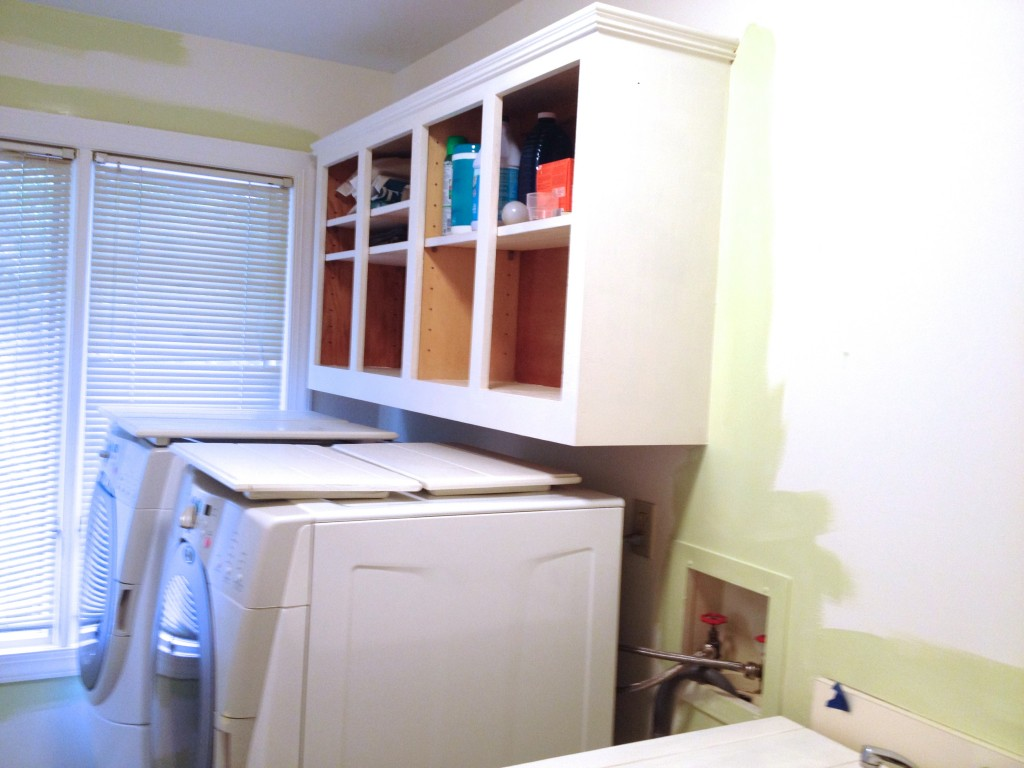 Simple  low cost laundry room makeover in soothing aloe green featured on Remodelaholic