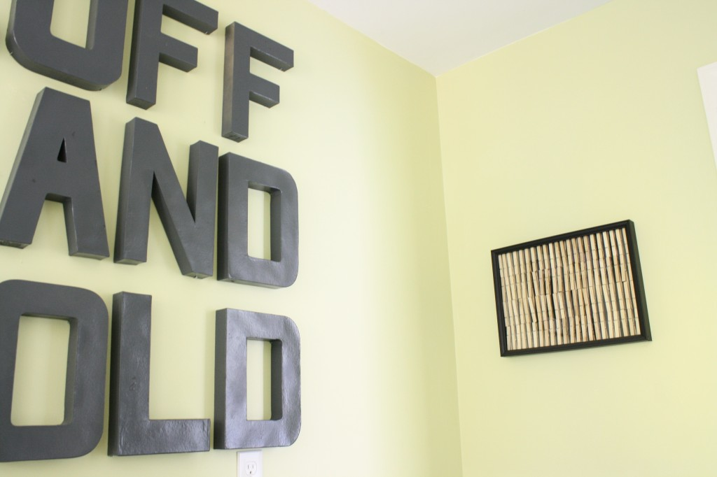 Lovely  low cost laundry room wall decor featured on Remodelaholic