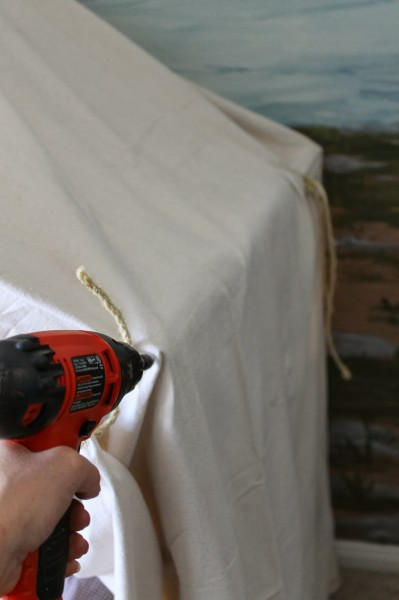 use screws to attach canvas to dowels for indoor camping tent bed, The Ragged Wren on Remodelaholic