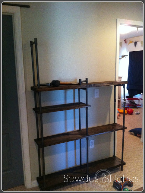 Make Industrial Style Shelving On A Budget Remodelaholic