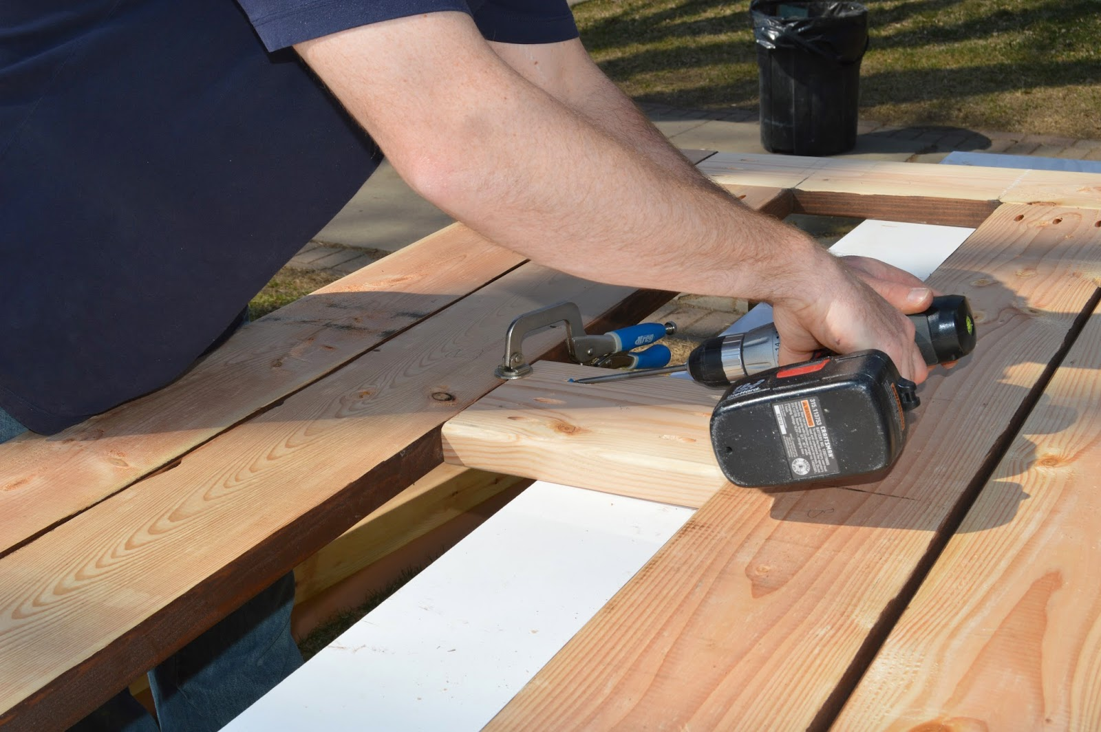 Remodelaholic build a patio table with built in ice boxes for Best builders workshop deck