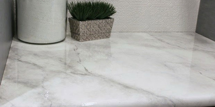 Remodelaholic DIY Faux Marble Countertops - Fake marble bathroom countertops