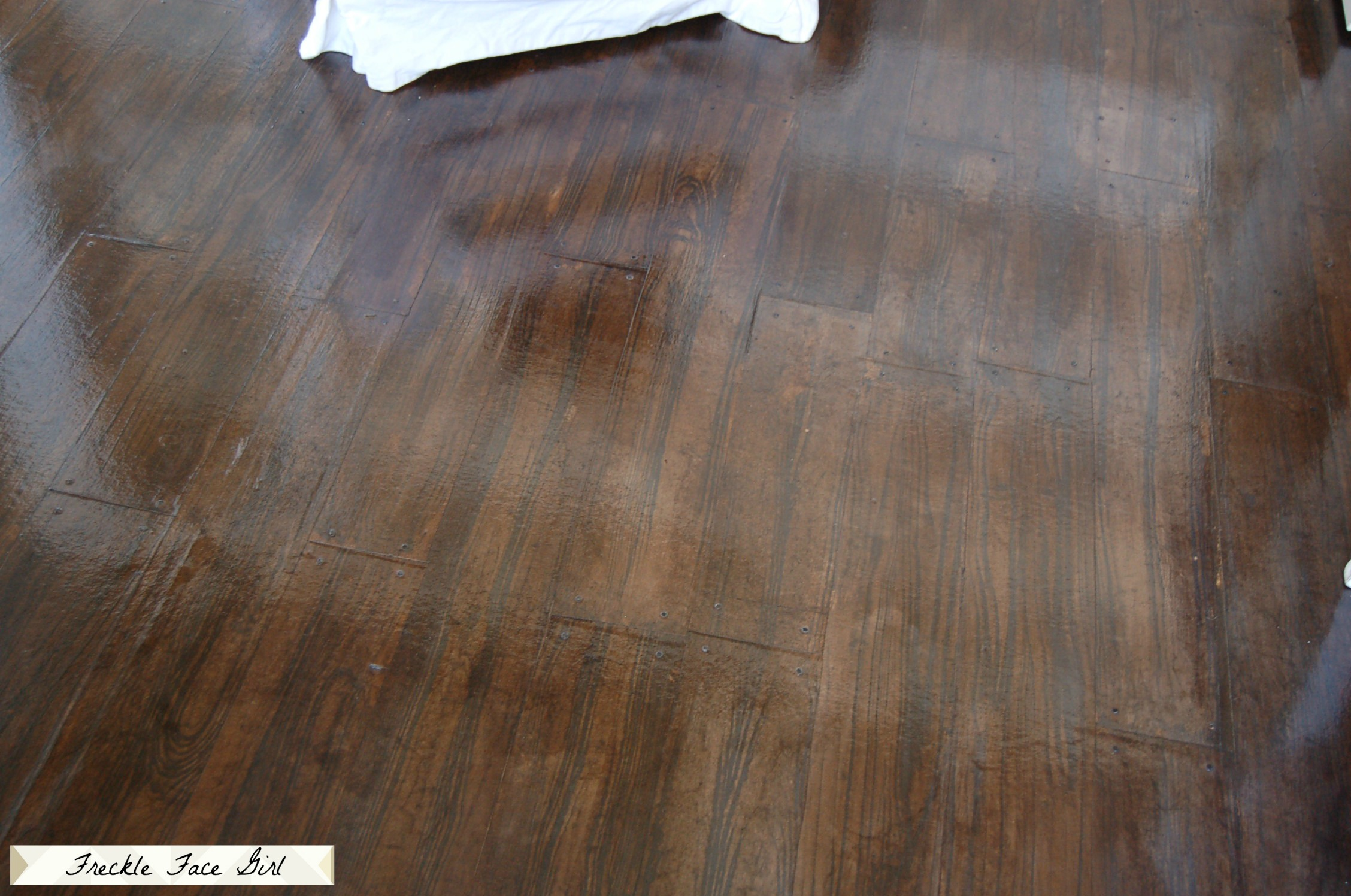 remodelaholic faux wood plank floors using brown paper. Black Bedroom Furniture Sets. Home Design Ideas